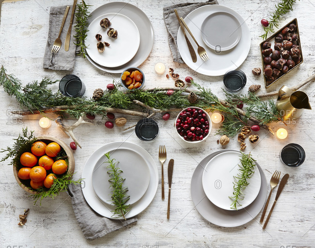 Rustic place settings and various fruits