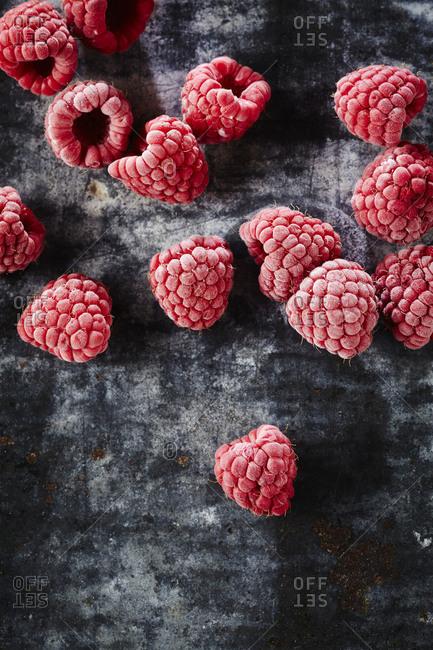 Close up of raspberries on dark background
