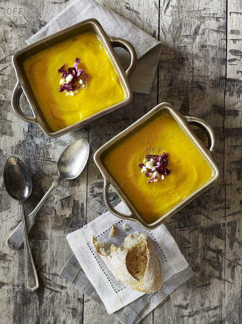 Two bowls of squash puree and bread