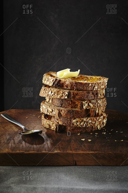 Stack of hearty bread with butter and honey