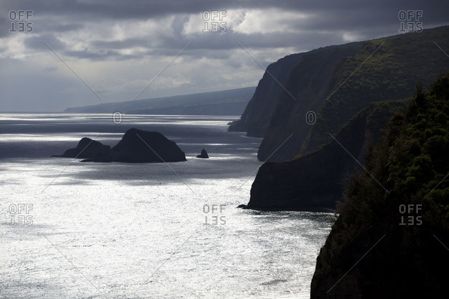 Overcast sky above cliffs