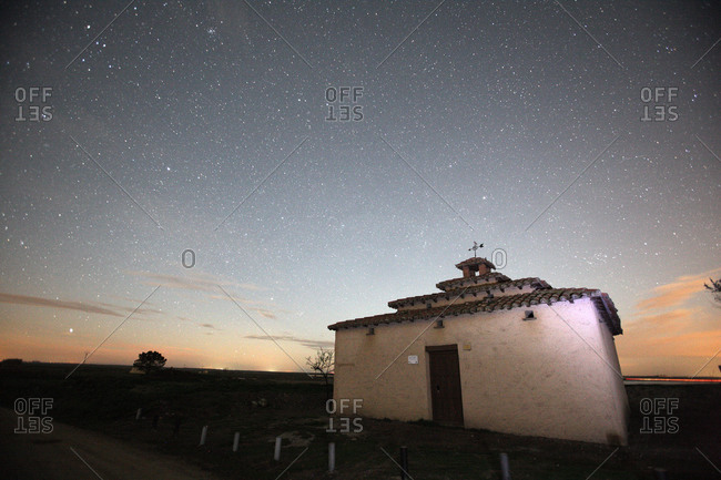 Building at a crop field at night under starry sky, Zamora, Spain