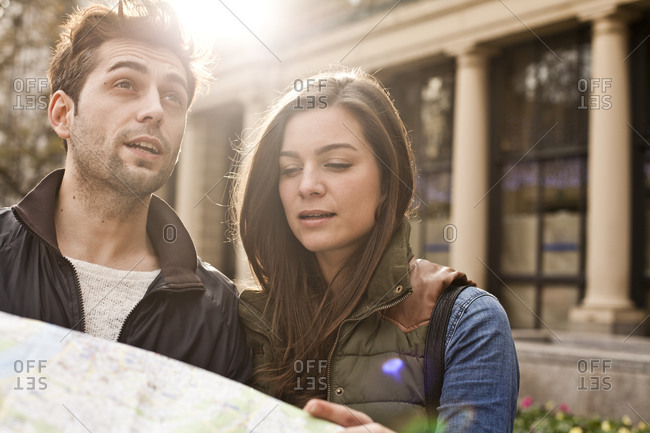 Young couple with city map