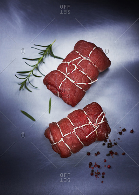 Raw beef roulades, pepper and rosemary