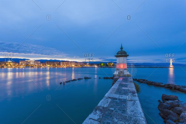 Lake Geneva with harbor mole in the evening