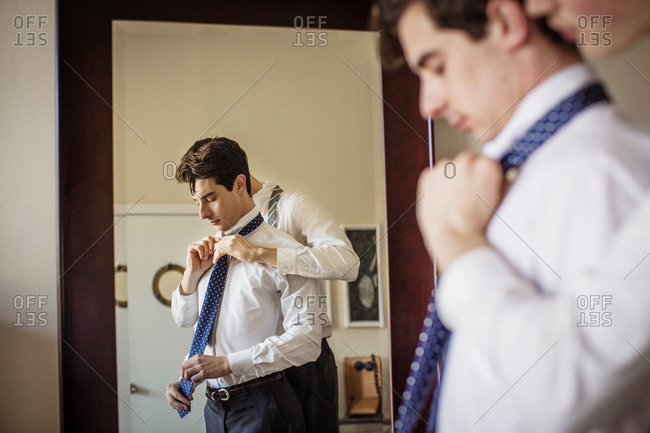 Man helping his partner with his tie