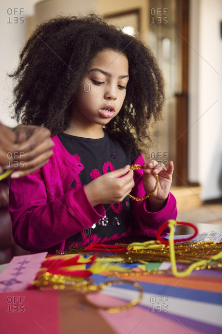 Girl making crafts at table