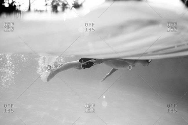 Boy swimming underwater holding breath