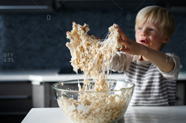 Young boy making crisped rice