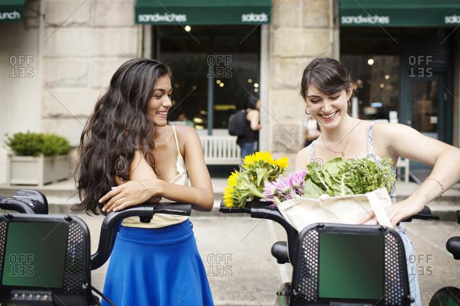 Two women using bike share