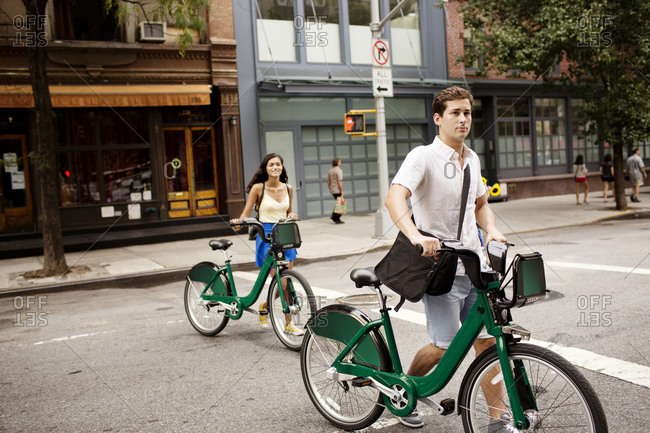 Young couple using bike share in New York City, USA