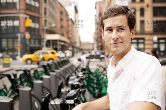 Man using bike share in New York City, USA