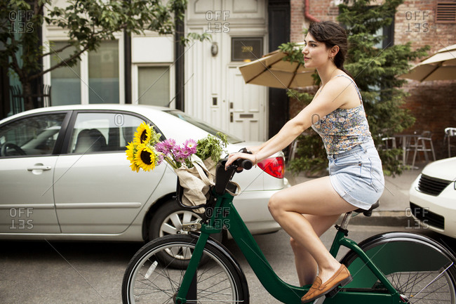 Young woman using bike share in New York City, USA