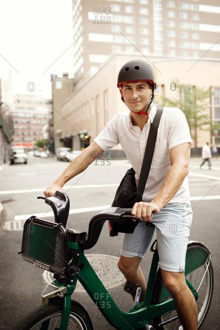 Man with a helmet using bike share