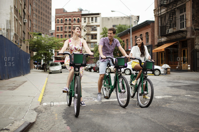 Friends using bike share in New York City, USA