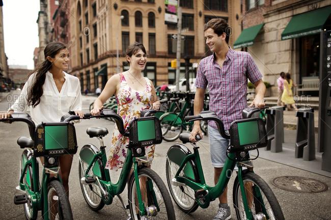 Three friends using bike share together