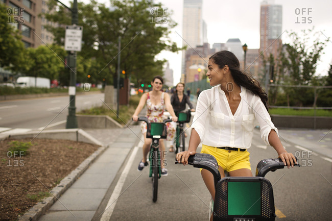 Young people using bike share in New York City, USA