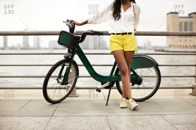 Young woman posing with bike share