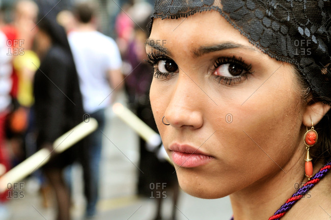 Granada, Spain - April 16, 2014: Portrait of young woman at Holy Week procession in Granada, Spain