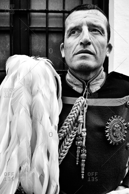 Granada, Spain - April 16, 2014: Portrait of a guard in traditional uniform during Holy Week in Granada, Spain