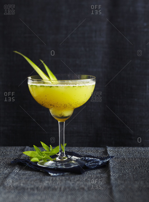 A fruity cocktail against a dark background