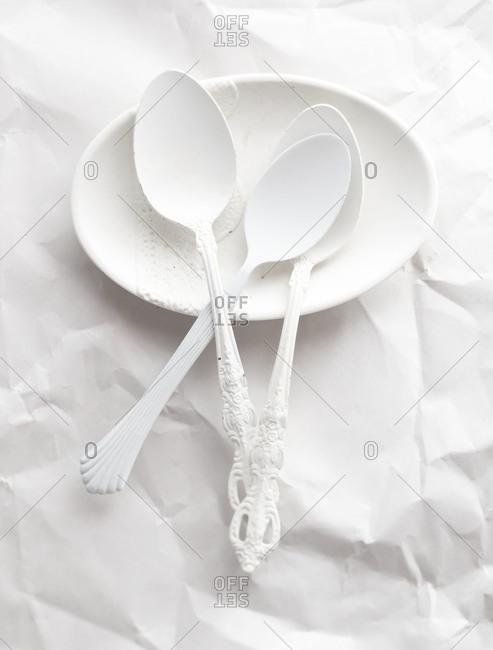 White spoons on a white tray