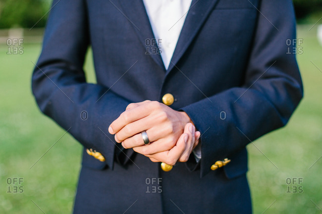 Groom's hands with wedding band