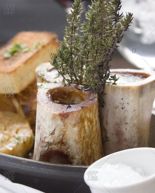 Marrow bones served with herbs