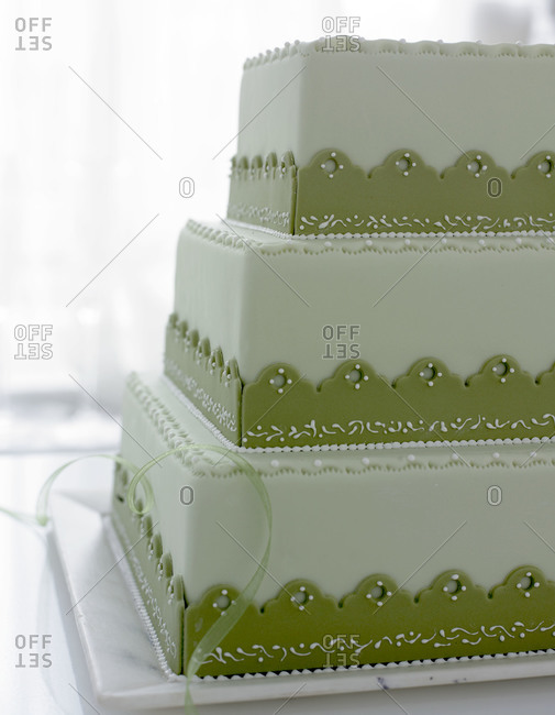 Tiered cake with green decoration