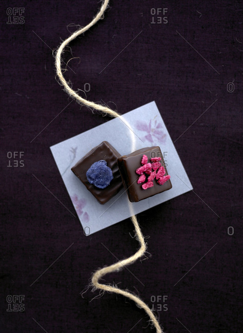 Studio shot of stylish desserts on wrapping paper