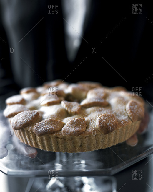 Person holding a freshly baked pie