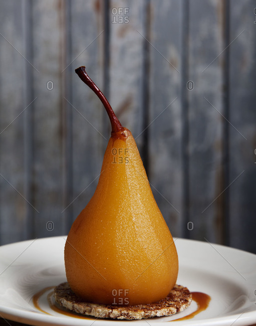 Poached pear served on a plate
