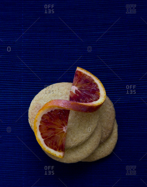 Stack of cookies with a slice of blood orange