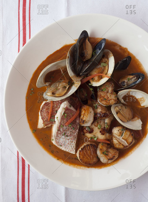 Rich soup with mussels, scallops and fish