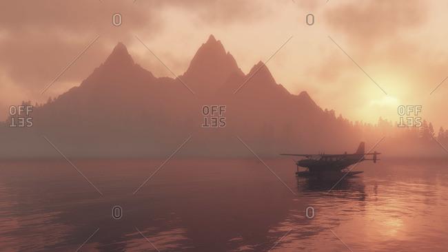 Seaplane floating on a lake at sunrise