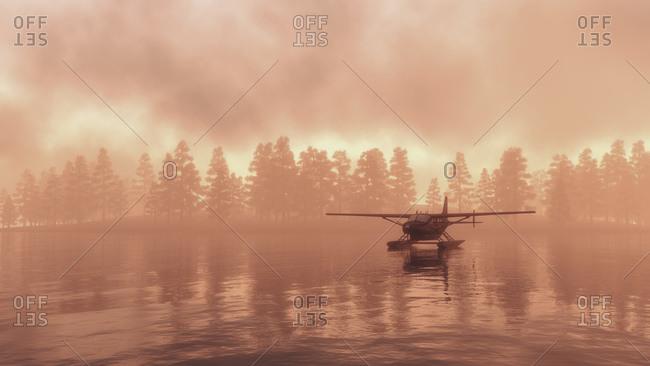 Seaplane landing on a lake at sunrise