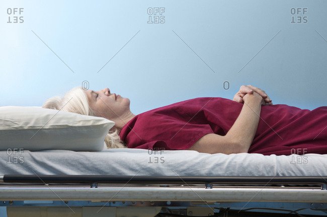 Woman resting on a hospital bed