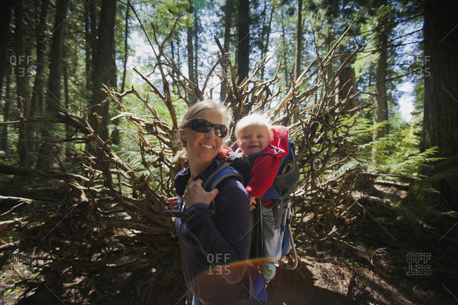 Woman with son on trail of cedars, Montana, USA