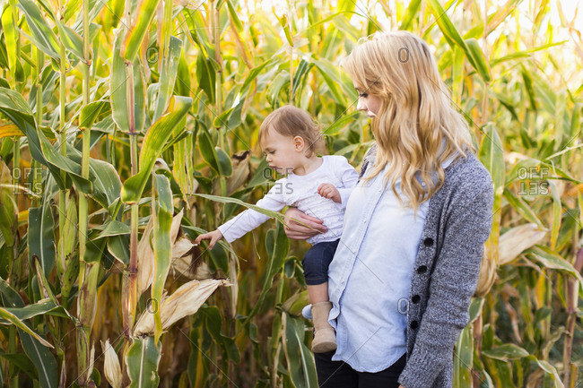 Mother and daughter in corn field