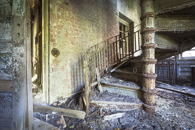 Decaying spiral staircase in a n abandoned hospital on North Brother Island