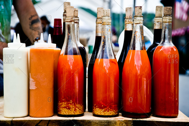 Different condiments and bottled sauces