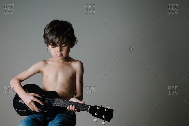 Portrait of a boy with an ukulele