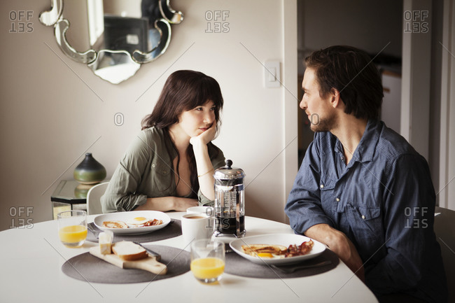 Couple sharing intimate breakfast at home