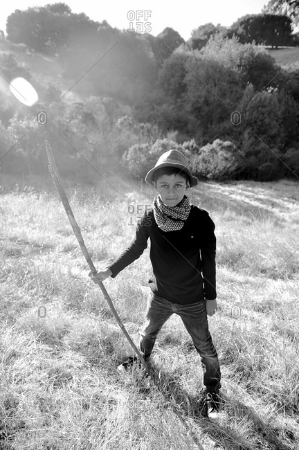 Boy posing with a stick