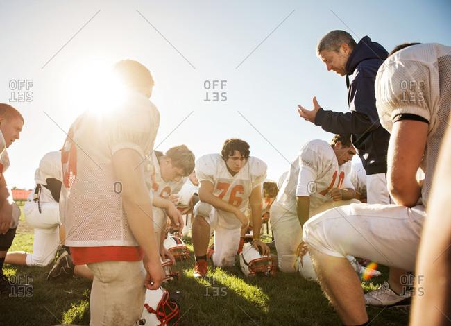 A high school football coach motivates his team