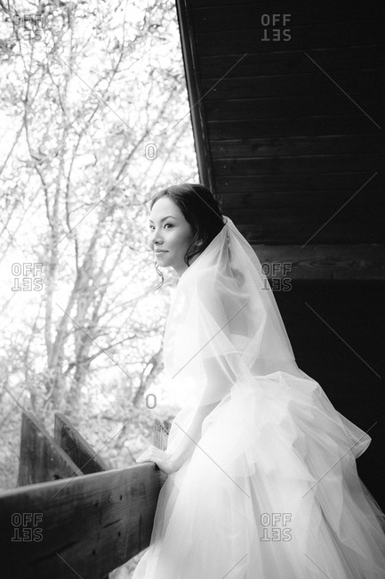 Charming bride on balcony smiling