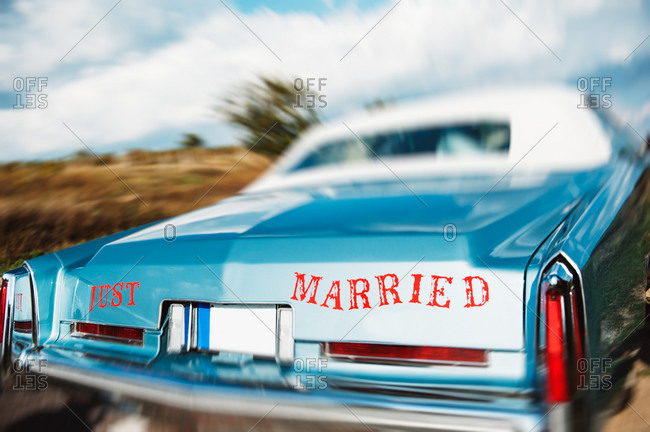 The Just Married signage on the back of an American vintage car