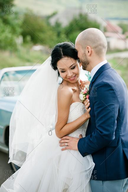 Groom kissing lovingly the bride