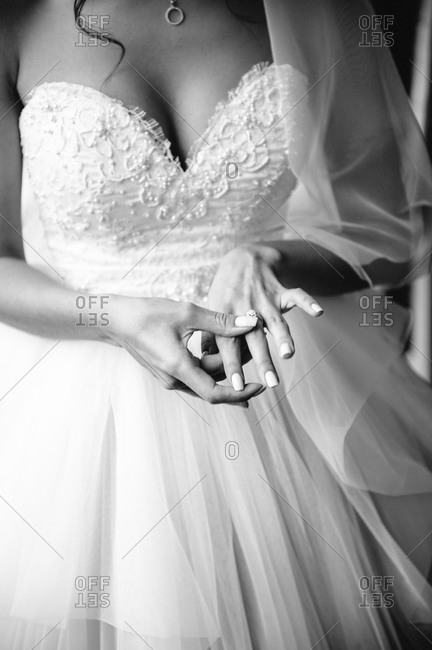 Close-up of bride putting on ring
