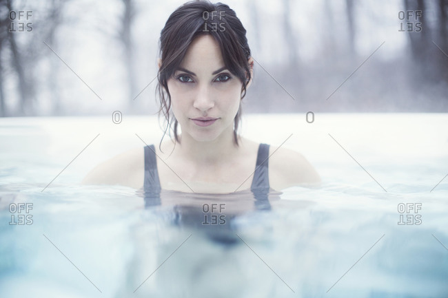 Portrait of young woman in pool in winter